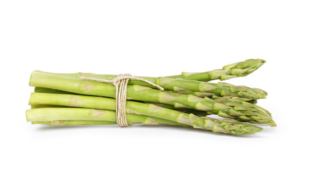 uncooked green asparagus tied with twine, isolated on white 版權商用圖片 - 25175109