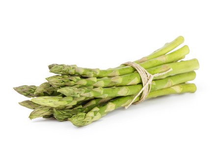 uncooked green asparagus tied with twine, isolated on white photo
