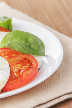 caprese salad with balsamic made on white plate photo