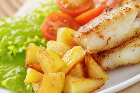 codfish: roasted codfish fillet with vegetables, selective focus Stock Photo