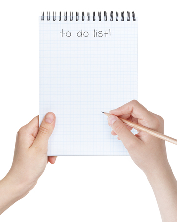 female teen girls holding notepad with to-do list, isolated on white photo