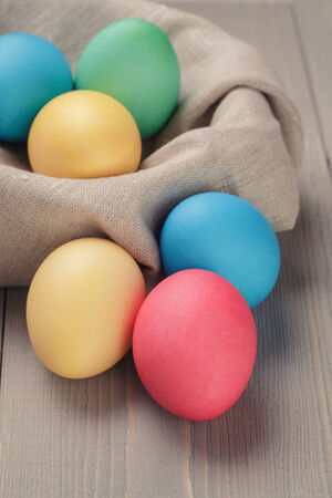 easter eggs in nest from sack textile, rustic style photo