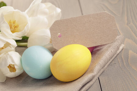 easter eggs with tulips on table, card with copyspace photo