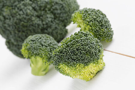 fresh broccoli on wood board, healthy eating photo