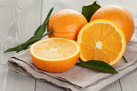 ripe oranges on wooden table, rustic style Stock Photo