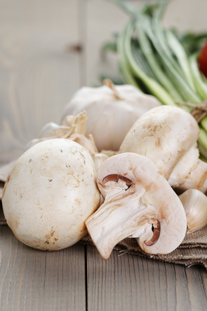 bulb and stem vegetables: fresh vegetables on napkin, rustic style photo