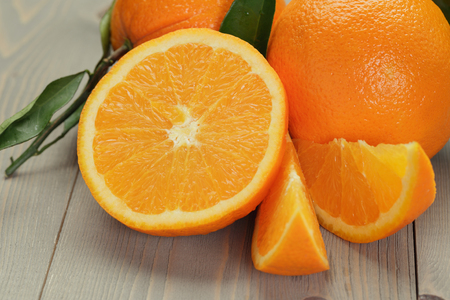 navel orange: ripe oranges on wooden table, rustic style Stock Photo