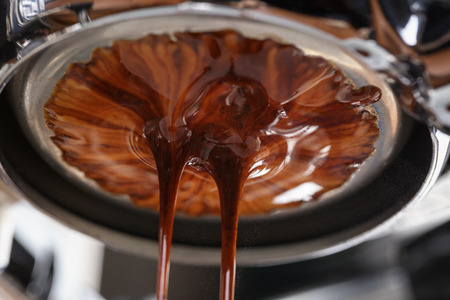 espresso coffee extraction with bottomless filter, close up
