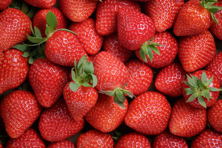 fresh ripe strawberries background, shot directly above
