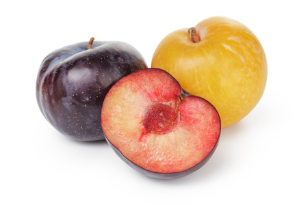 three ripe plums, isolated on white background