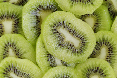 kiwi slices close up, organic fruits background photo