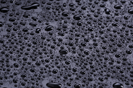 hydrophobic: water drops on hydrophobic plastic surface, close up Stock Photo
