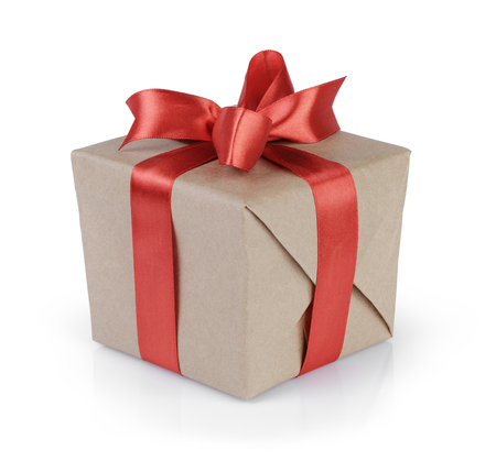 cube gift box wrapped with kraft paper and red bow, isolated 写真素材