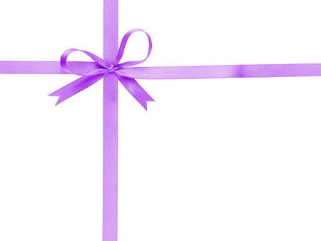 purple thin ribbon with bow cross, isolated on white photo