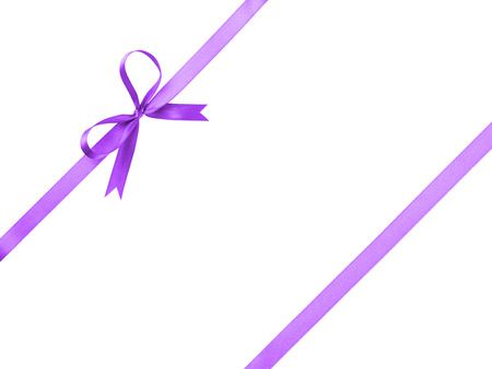 purple thin ribbon with bow composition, isolated on white photo