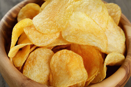 potato chip: potato chips with paprika, close up photo