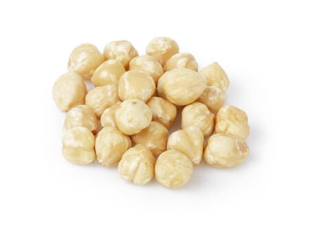 cleaned: peeled and cleaned hazelnut kernels, isolated on white