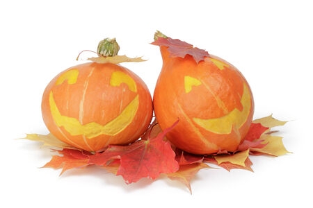 halloween pumpkins with funny face, isolated on white photo