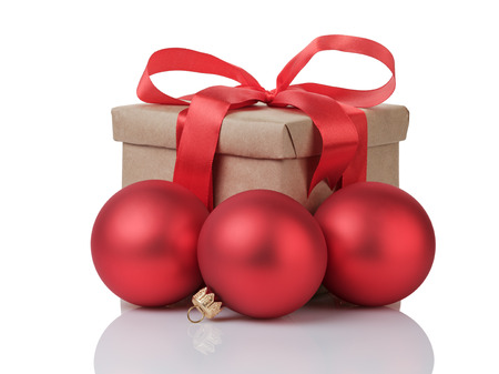 wraped gift box with red bow and christmas balls, isolated on white photo
