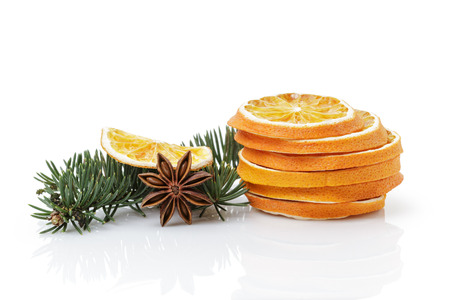traditional christmas decorations dried orange anise star, isolated on white photo
