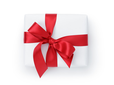 red ribbon bow: white gift box with ribbon bow from above, white background