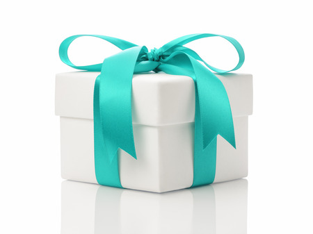 traditional gifts: white gift box with azure ribbon bow, isolated on white