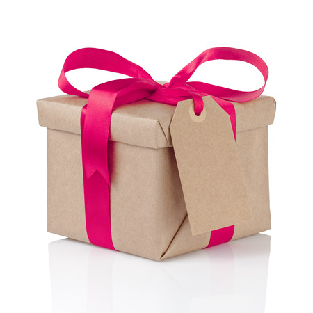 gift christmas box wrapped with kraft paper and purple bow, isolated