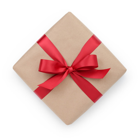 kraft paper gift box with ribbon bow from above, white background