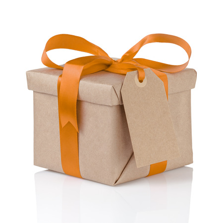 one gift christmas box wrapped with kraft paper and orange bow, isolated Stok Fotoğraf