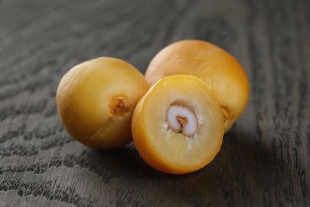 oal: fresh raw dates on table, old oak wood
