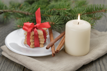 christmas composition with cookies and candle, rustic photo photo