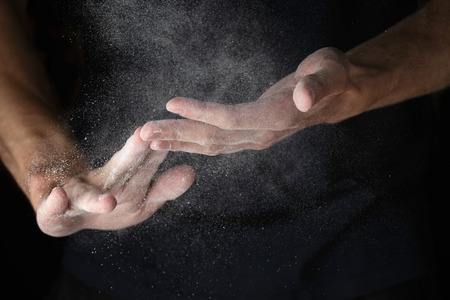 male symbol: adult man hands work with flour Stock Photo