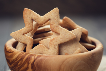 classic star cookies in wood bowl, on oak table photo