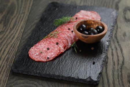salami slices: Salami slices slate board, rustic style food Stock Photo