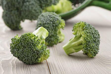 fresh broccoli on wood rustic table photo