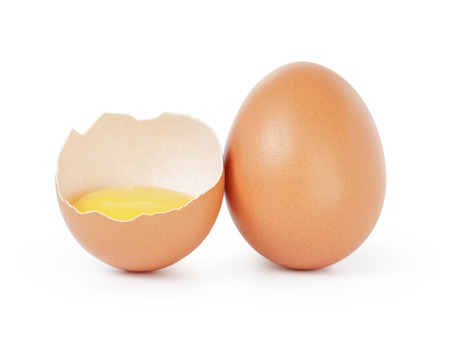 broken egg: raw brown chicken egg isolated Stock Photo