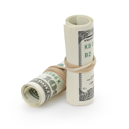 rolled hundred dollar banknotes tied with rubberband photo