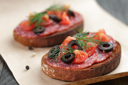 air dried salami: open rye sandwich with salami and vegetables Stock Photo