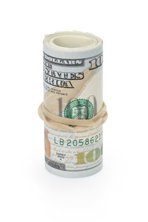 rubberband: rolled hundred dollar banknotes tied with rubberband