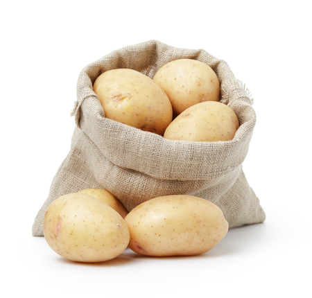 raw fresh potatoes in burlap bag isolated on white Stockfoto