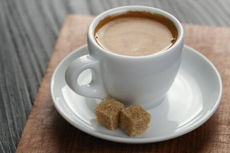 crema: cup of freshly made espresso on wood board