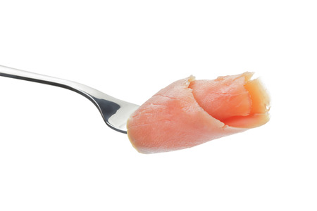 mouthful: rolled curred salmon on fork isolated on white background Stock Photo