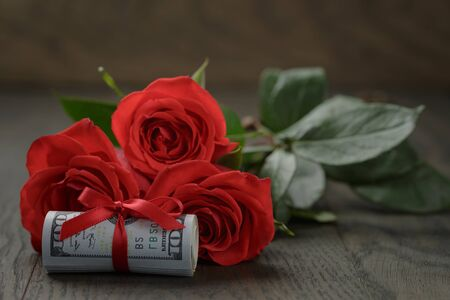 three red roses and bunch of dollars photo