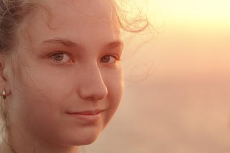 teen girl bikini: Portrait of a beautiful teen girl in the sunset on the sea