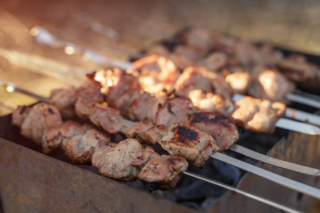 chargrill: cooking pork shashlik on skewer in mangal outdoor food