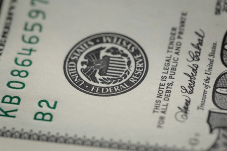 macro photo of federal reserve system symbol on hundred dollar bill Stock Photo