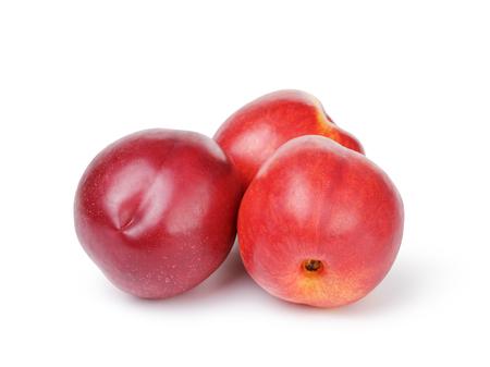 whole nectarine fruits isolated on white photo