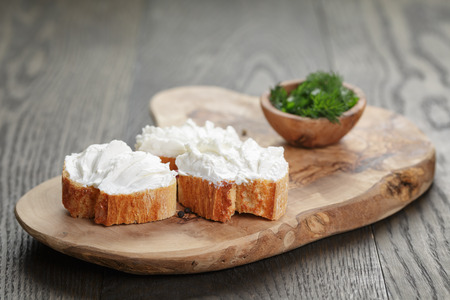 sliced cheese: homemade appetizing crostini with soft cheese cream herbs Stock Photo