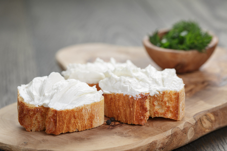 homemade appetizing crostini with soft cheese cream herbs Standard-Bild