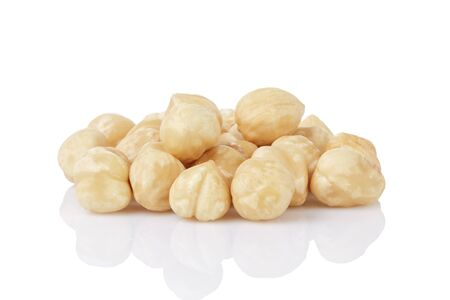 heap of peeled hazelnuts isolated